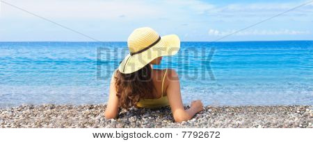 Woman lying on a beach