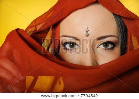 Young Beautiful Woman Eyes In Indian Traditional Jewellary, Bindi , Sari Dress And Makeup. Yellow Ba