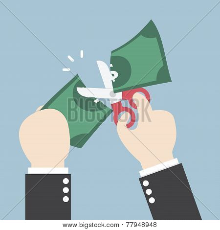 Businessman Hands Holding Scissors And Cutting Dollar