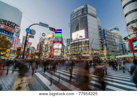 Tokyo, Japan - November 28, 2013: Crowd At The Famed Crossing Of Shibuya District