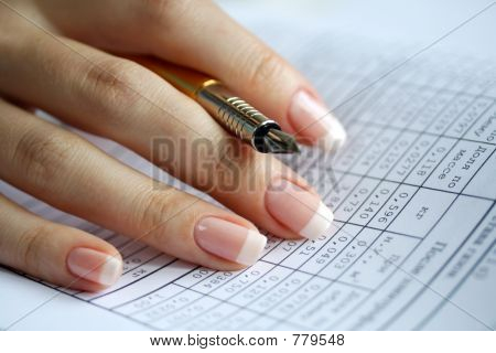 Holder  in a female hand, table of data