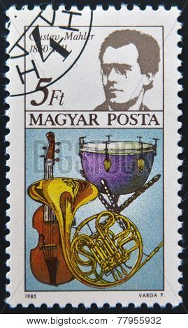 HUNGARY - CIRCA 1985: stamp printed in Hungary shows Gustav Mahler pardessus de viole kettle drum