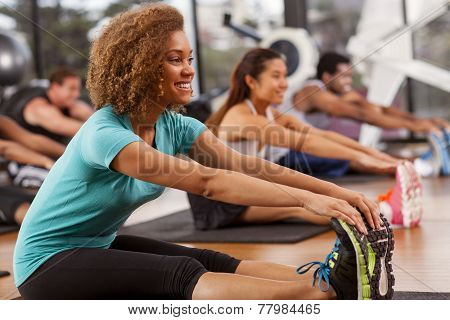 Young Woman Stretching In A Gym