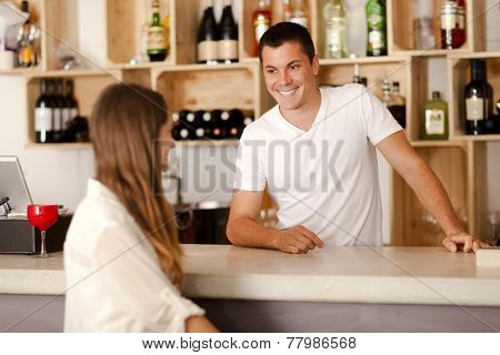 Barman Smiling At Female Customer