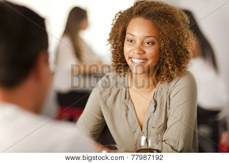 Young Mixed-race Woman In A Restaurant