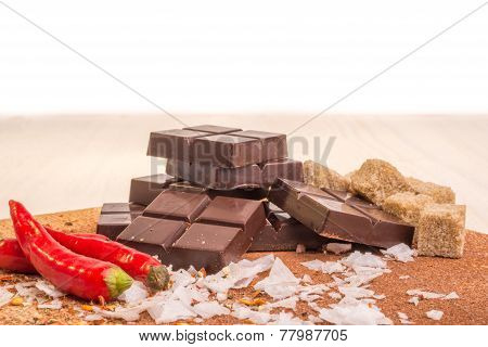 Artisan chocolate with some of the ingriedients that goe in to these chocolates. poster
