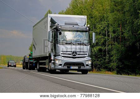 Grey Mercedes-Benz Antos Truck On The Road