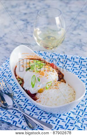 Loco Moco with venison chili rice and a poached egg poster