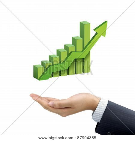 Businessman's Hand Holding Bar Graph With Rising Arrow