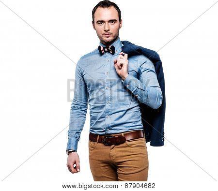 Sharp dressed fashionist with jacket over shoulder