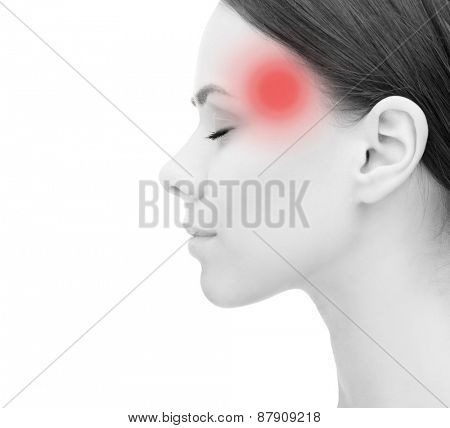 health, people and medicine concept - face of beautiful young woman suffering from headache