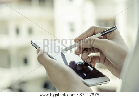 A woman using tablet with stylus pen
