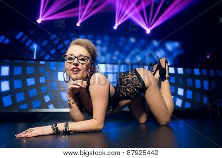 Young sexy woman in night club on dance floor