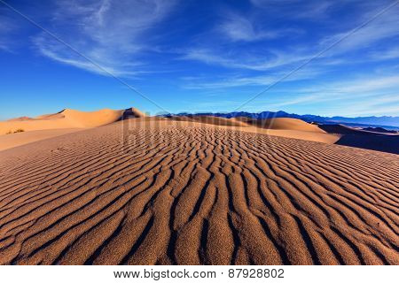 Thin waves on sand. Bright solar morning in picturesque part of Death Valley, USA. Mesquite Flat Sand Dunes, Stovepipe Wells Village