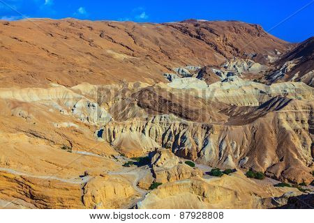 Ancient mountains in the valley of the Dead Sea. Picturesque multi-colored taluses dry sandstone