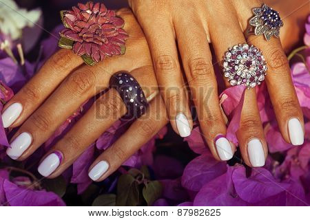 bright colorfull shot of african tanned hands with manicure amon