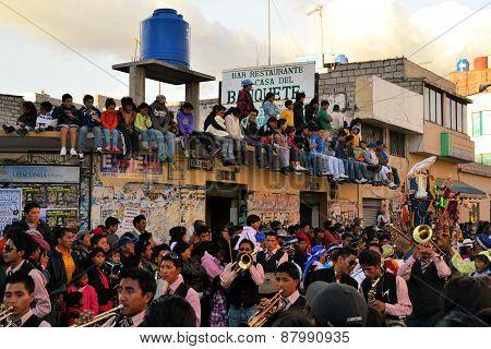 Latacunga, Ecuador 30 September, 2012: Onlookers are watching the parade for La Fiesta de la Mama Negra traditional festival in Latacunga, Ecuador.