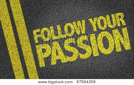 Follow Your Passion written on the road poster
