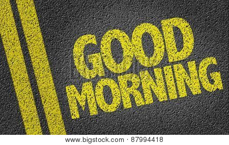 Good Morning written on the road poster