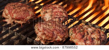 BBQ Beef Burgers on Hot Charcoal Grill. Dancing Flames On The Background poster