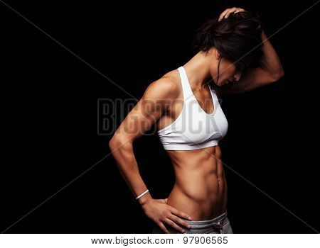 Fit Young Woman In Sports Wear Looking Down