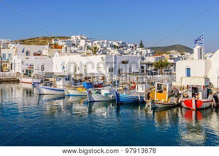 multicoloured boats and promenade