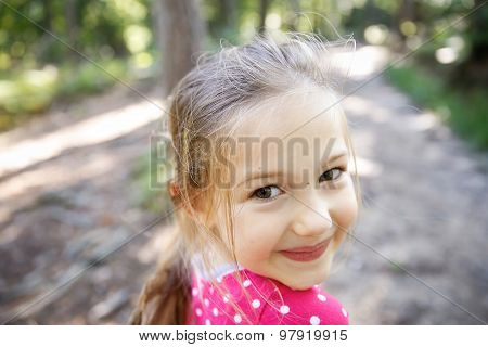 Little Girl Enjoying A Hike Through The Woods