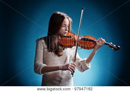 beautiful girl plays on violin