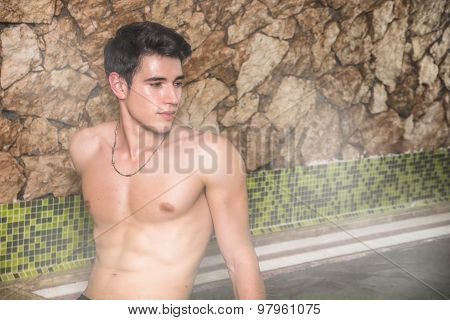 Young Man Relaxing in Steam Bath, Sweating