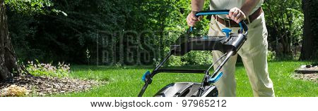 Senior Male With Lawnmower