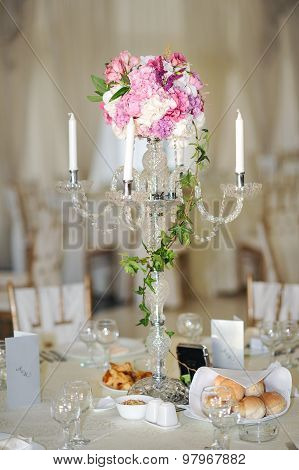 Antique candlestick with wedding bouquet.wedding candlestick with flower decoration before wedding