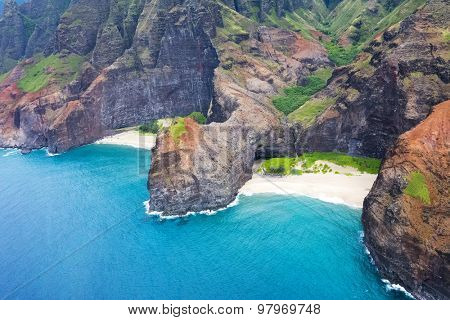 An aerial view of the Na Pali coast's jutting cliffs at Honopu Valley during a helicopter tour of the coast.