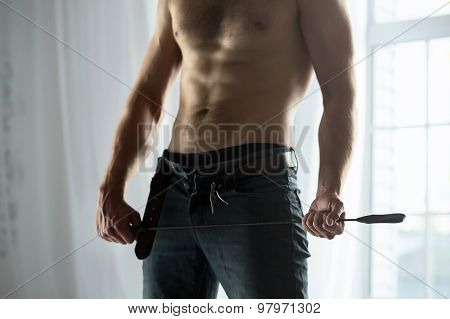 Handsome guy topless with whip BDSM