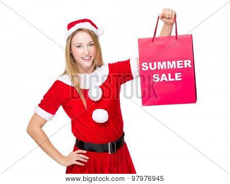 Christmas party dressing girl with shopping bag showing summer sale