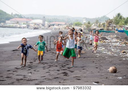 Children Group On The Beach With Volcanic Sand Near Mayon Volcano, Philippines