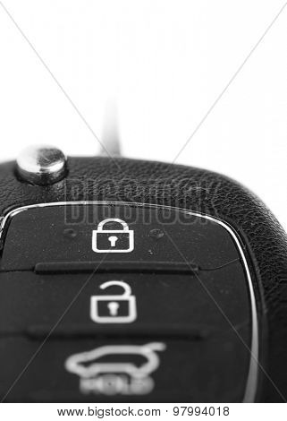 Car key with focus on lock symbol create with multi photo stacking