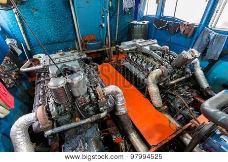 Big boat engine inside a tourist passenger boat in Thailand