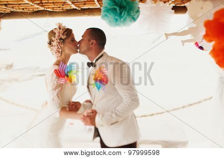 Beautiful  Gorgeous Blonde Bride  And Stylish Groom Kissing, Hawai  Colorful Sand Ceremony