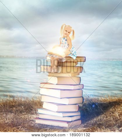 Adventure story and fairy tale. Tiny girl with books and magic glowing on landscape background