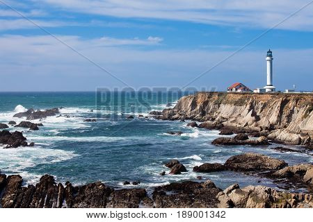 Pacific Ocean coastal landscape with Point Arena Lighthouse California CA USA