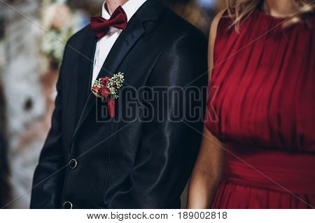 Bridesmaid Holding Rustic Bouquet With Groomsman,  Couple In Church During Wedding Ceremony, Religio