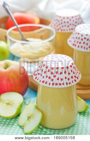 Homemade apple sauce or apple puree in a glass jar