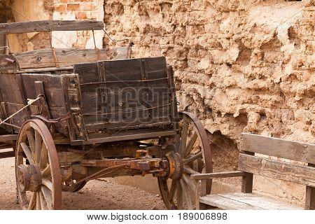 Vintage Western Horse Cart Dusty Mud Brick Wall