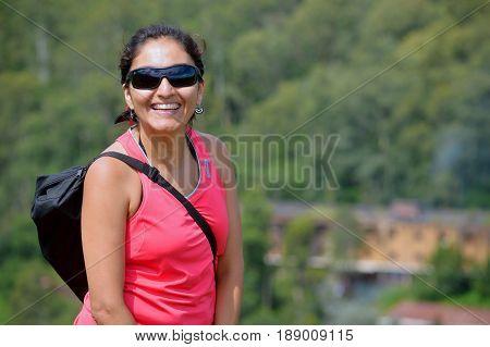Beautiful happy woman walking the yungas jujeñas, argentina