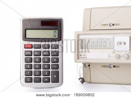 Device for metering of electricity consumption and calculator on a white background. Payment of electricity.