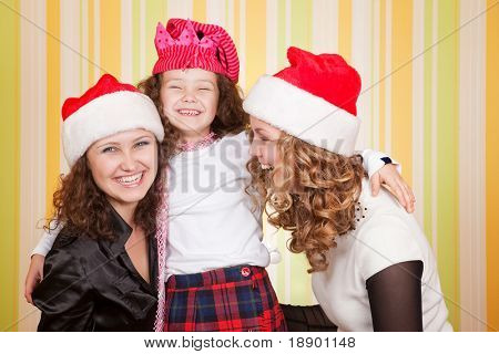 young and beautiful caucasian family celebrate christmas
