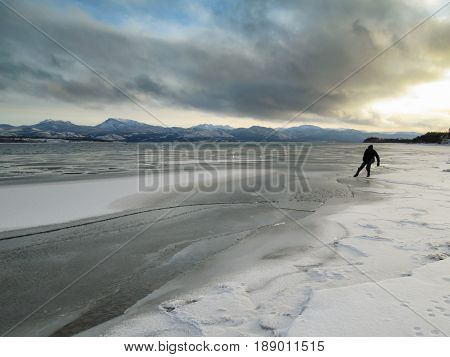 Man Tests Ice Lake Laberge Freeze-up Yukon Canada