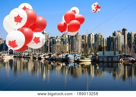 Canada day maple leaf balloons floating over Vancouver's Coal Harbour.