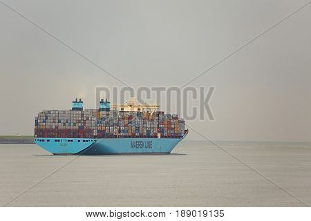ROTTERDAM, THE NETHERLANDS - SEPTEMBER 22: Maersk Triple E class container ship leving the Port of Rotterdam, 22th of September, 2015. It's one of the largest container ships, 400m long, 18000 TEU