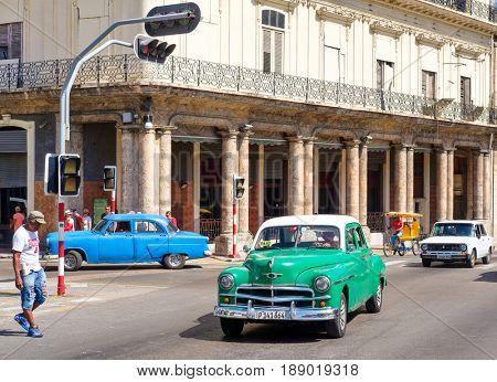 HAVANA,CUBA - MAY 29, 2017 : Street scene with vintage american cars in downtown Havana